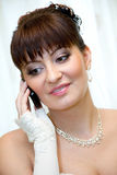 Bride talking on mobile phone. Young beautiful bride talking on mobile phone stock photos