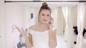 Bride talking on the phone stock footage