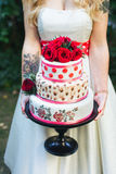 The bride with tattoos holding gifts. Royalty Free Stock Photo