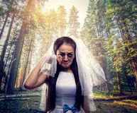 Bride with tearful face, pine forest on background Royalty Free Stock Photos
