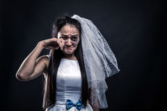 Bride with tearful face, unhappy marriage. Studio photo shoot on black background Stock Photos