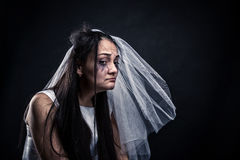 Bride with tearful face, unhappy marriage. Studio photo shoot on black background Stock Photography