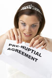 Bride Tearing Up Pre-Nuptial Agreement Stock Images