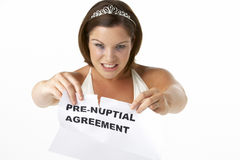 Bride Tearing Up Pre-Nuptial Agreement royalty free stock photo