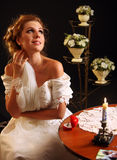 Bride thinking about choice of groom. Woman in wedding dress. Stock Photos