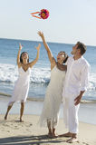 Bride Throwing Bouquet On Beach Royalty Free Stock Photography