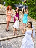 Bride throwing bouquet. Outdoor Royalty Free Stock Photos