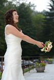 Bride throwing flower bouquet Royalty Free Stock Photo