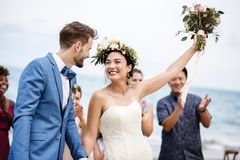 Bride throwing flower bouquet to guests royalty free stock photos
