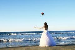 Bride throwing flowers Stock Photo