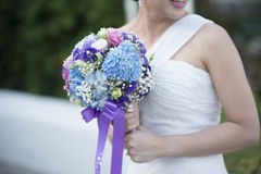 Bride throwing flowers blurred Royalty Free Stock Images