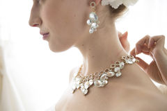 Bride to get with a necklace Royalty Free Stock Photos