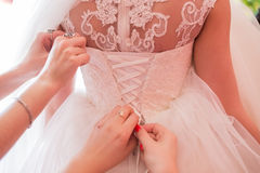 Bride to put her wedding dress Stock Photography