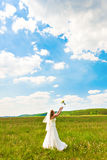 Bride tossing the bouquet Royalty Free Stock Images