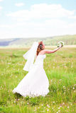 Bride tossing the bouquet Stock Image