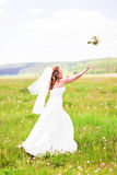 Bride tossing the bouquet Stock Photo