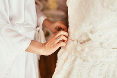 Bride touch white dress by hands with ring before begining prepo Royalty Free Stock Images