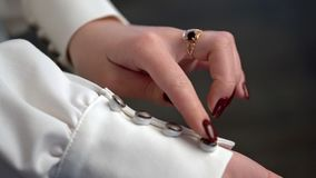 The bride touches the buttons with her hands on the wedding dress-2. stock video footage