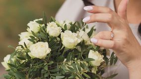 The bride touches the wedding bouquet. stock video
