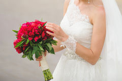 Bride Touching Bouquet Royalty Free Stock Photo