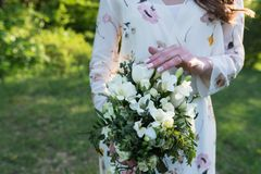Bride touching wedding bouquet with one hand with wedding ring on her finger. Wedding. Details Royalty Free Stock Photos