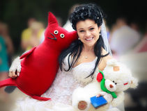 Bride with toys Royalty Free Stock Photography