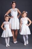 Bride With trhee little Bridesmaids, indoor studio shot stock photography