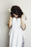 Bride tries on a wedding dress royalty free stock photography