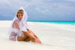 Bride on a tropical beach Stock Images