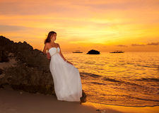The bride on a tropical beach with the sunset in the background Royalty Free Stock Images