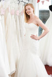 Bride Trying On Wedding Dress In Bridal Boutique Royalty Free Stock Photography