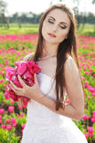 Bride in tulips field Royalty Free Stock Images
