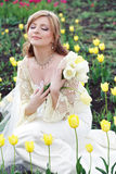 Bride in tulips field Royalty Free Stock Photo
