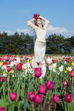 Bride in tulips field Stock Photos