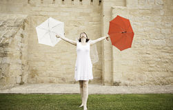 Bride with two umbrellas Stock Photos