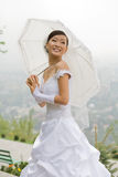 Bride with umbrella Royalty Free Stock Photos