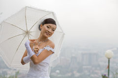 Bride with umbrella Royalty Free Stock Photo