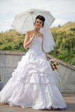 Bride with umbrella Royalty Free Stock Photography