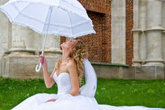 Bride with  umbrella Stock Photos
