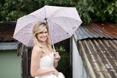 Bride with Umbrella Stock Photo