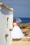 Bride with umbrella Stock Image