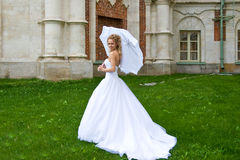 Bride with  umbrella_3 Royalty Free Stock Image