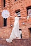 Bride with umbrella Stock Photo