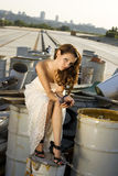 Bride on under construction road. Holding cherries Stock Photography