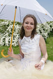 Bride under the parasol Stock Photos