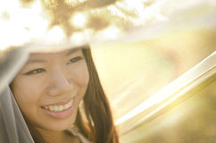 Bride under veil. Asian bride under veil at outdoor in a morning surrounding by golden sunlight Stock Photo
