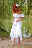 Bride or undine,. Coming out of the river in thickets of willow royalty free stock photo