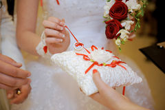 Bride Unknotting Ring Royalty Free Stock Photos