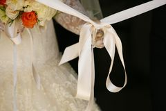 the bride unties the bow before leaving the house stock images