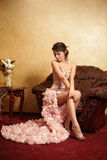 Bride in unusual wedding dress in the in interior Royalty Free Stock Photo